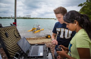 Marine scientist Kevin Boswell and his students use a remote-controlled autonomous survey vessel to characterize the habitats and water quality of coastal waters.