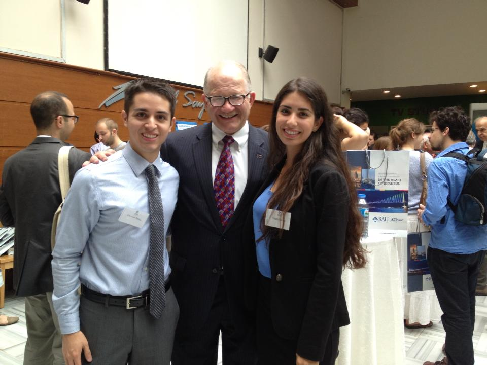 Bruna (left) and Balzan (right) pose with FIU President Mark B. Rosenberg at the opening ceremony of the International Summer University for Intercultural Leadership.