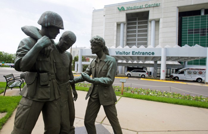 Three statues portraying a wounded soldier being helped, stand on the grounds of the Minneapolis VA Hospital (Photo: Jim Mone, AP).
