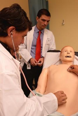 Jonathan Kapitansky auscultates Harvey's abdomen