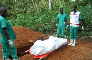 Red cross workers prepare to bury a victim of Ebola