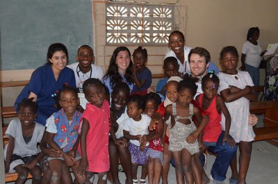 HWCOM students pose with some patients during medical mission to Haiti.