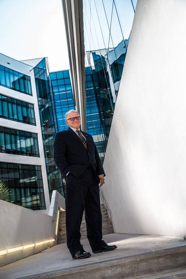 President Rosenberg stands outside Academic Health Center 5