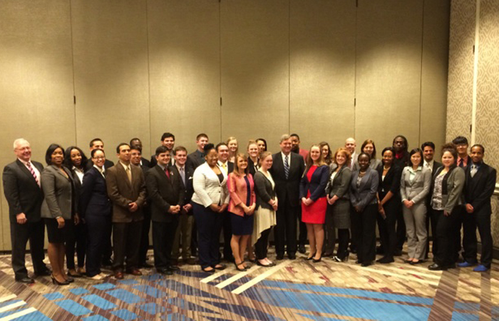 Participants of the USDA's 2014 Agricultural Outlook Forum pose with Secretary of Agriculture Tom Vilsack.
