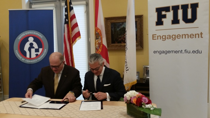 President Mark B. Rosenberg and USHCC President and CEO Javier Palomarez sign a partnership agreement at the Reagan House this week.