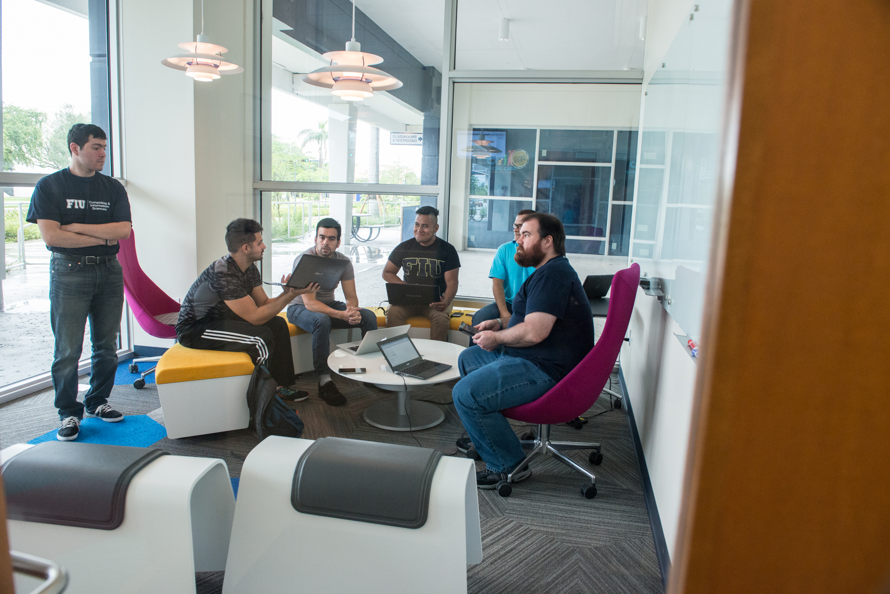Students in the School of Computing and Information Sciences collaborate on projects at FIU's Tech Station, which will be home to MangoHacks March 4 to 6.