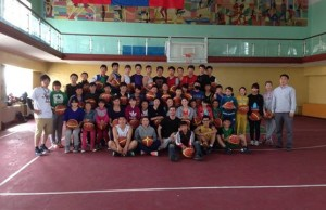 Murray with teachers, coaches and students at a basketball and leadership camp he organized.
