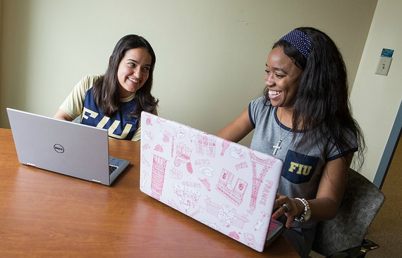 Success stories: Ashley Perez, left, and Tiana Lanier both participated in the Golden Scholars Program, which provides tutoring, mentoring and financial support to promising students from low-income families. Perez graduates in the spring while Lanier, a biology major intent on becoming a medical doctor, is a sophomore.