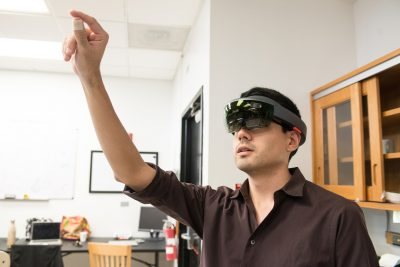 FIU graduate Chris Naranjo demonstrates the HoloLens