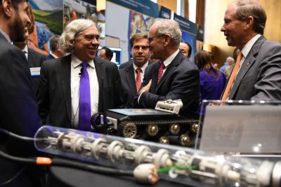 From left to right: Secretary Moniz, Senator Risch and Idaho Lab Director Dr. Peters tour the exhibits