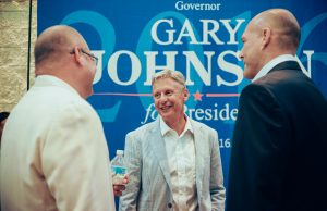 Libertarian Party presidential candidate Gary Johnson (center) speaks to supporters before his town hall event at FIU.