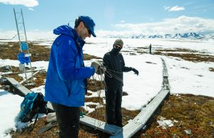 FIU ecologist Steven Oberbauer (left) conducts research in Alaska.