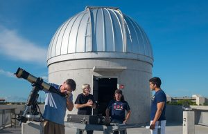FIU astroscientists look through a telescope at the Stocker AstroScience Center. By Eduardo Merille