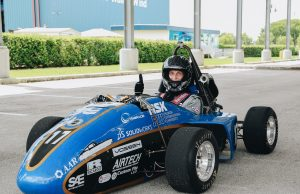 Provost takes engineering students' race car for a test drive