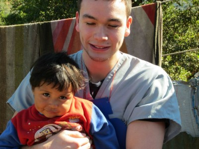 Michael O'Laughlin with Guatemalan boy during medical volunteer trip