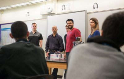 From left to right: Bryan Naranjo, Maikel Oliva, Juan Hurtado, Fernando Lerggios and Maria Romanowski (Team 7: Skyleep) presenting their senior design project to high school students at Jose Marti MAST Academy.