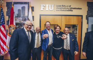 Left to right: President Mark B. Rosenberg, College of Engineering & Computing Dean John Volakis, Chad Moss '94, Sandra Moss, and Moss School Interim Director Jose Faria