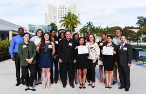 Nathan Kurland, center, and representatives from the Miami Bayside Foundation with students who have received support from the foundation's scholarships at FIU.