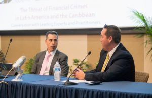 Kenneth Blanco, head of the financial crimes unit of the U.S. Department of the Treasury listens to Brian Fonseca, director of the Jack D. Gordon Institute for Public Policy during an event on financial crimes in Latin America.