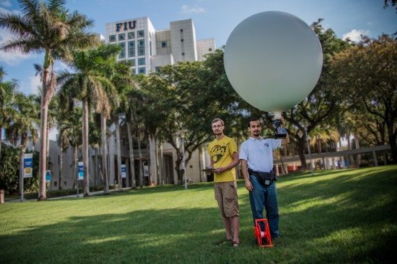 Students Jeremy McBride, left, and Raul Carmine Camarca use an aerial camera and balloon to take ultra-high-resolution photos for the Terrafly application.