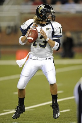 Quarterback Wesley Carroll looks for a receiver downfield in the first half against Toledo Rockets.