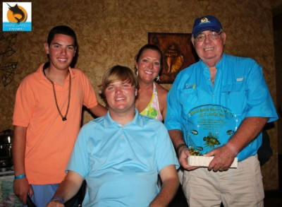 Woody Beckham (second from left) started the Woody Foundation in 2011 to help raise funds for people with paralysis.