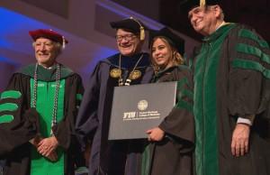 Dr. Herbert Wertheim, FIU President Mark B. Rosenberg, Class of 2014 grad Dr. Hanadys Ale, and HWCOM Dean John A. Rock, M.D., pose for a photo on inaugural graduation day