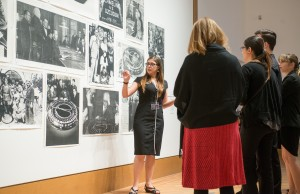 A&V students like Michelle Ozaeta (in black dress) led tours of the exhibit the opening night