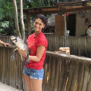 Miss FIU winner Andrea Mirabal is learning how to wrestle alligators at the Nature Village.