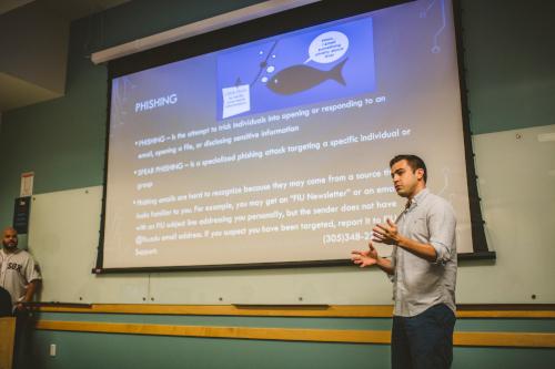 "Antonio Rubio, electrical engineering, explaining the concept of ""phishing"" to FIU retirees."