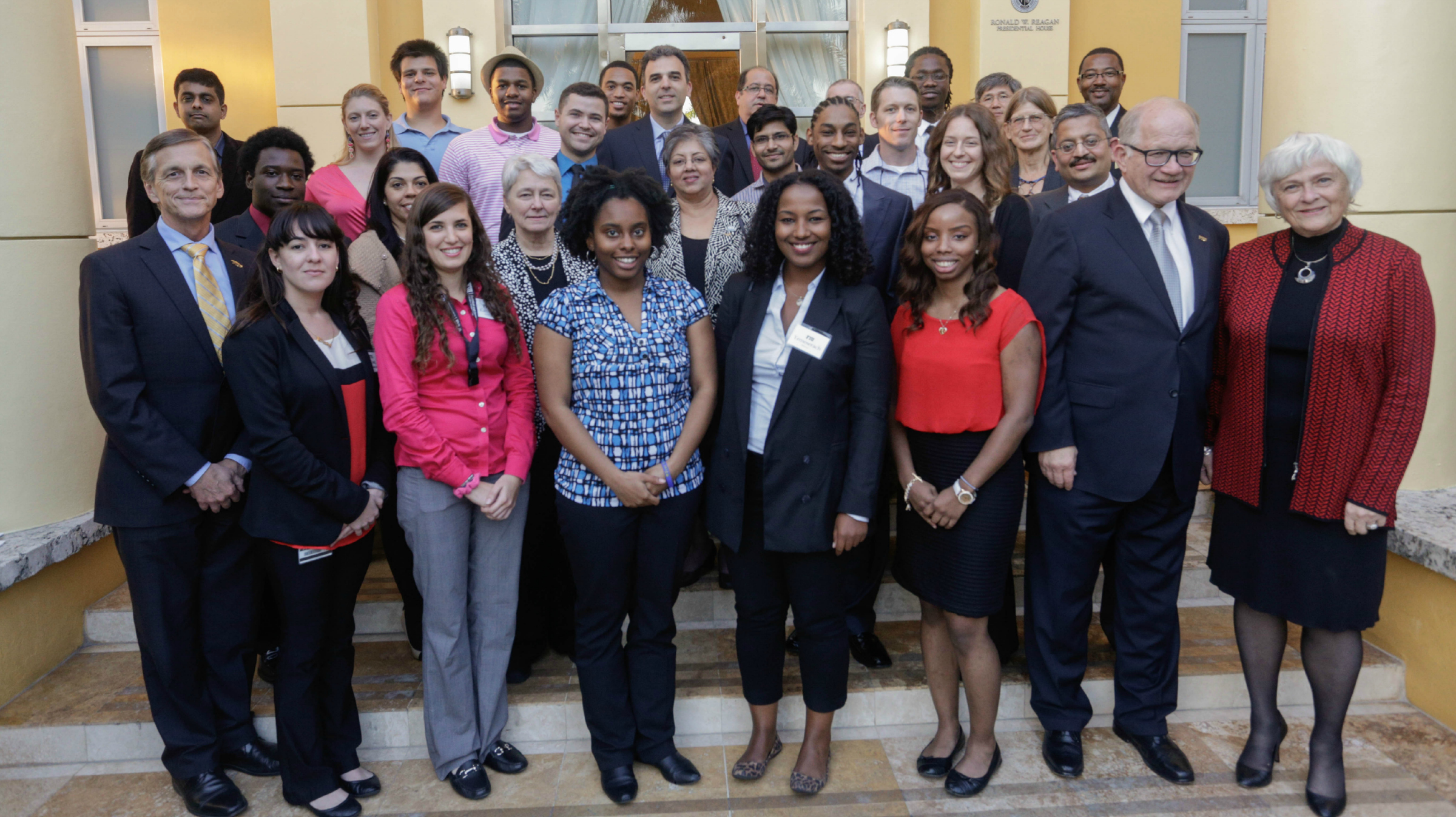 Members of the Bridge to the Doctorate program's current cohort celebrated with faculty mentors and university leaders at a reception with President Rosenberg.