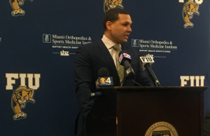 New men's basketball coach meets with media