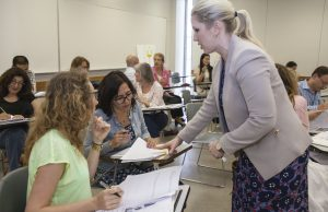 Linguistics professor Melissa Baralt leads a professional workshop as part of LACC's Title VI grant.