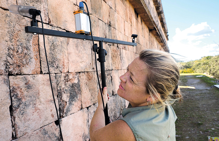 Bat expert Kirsten Bohn with bat song recording gear at Uxmal, Mexico. PHOTO: VIRGINIA MORELL/SCIENCE