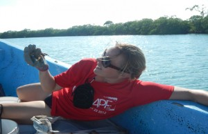 FIU marine scientists Heather Bracken-Grissom holds a crab.