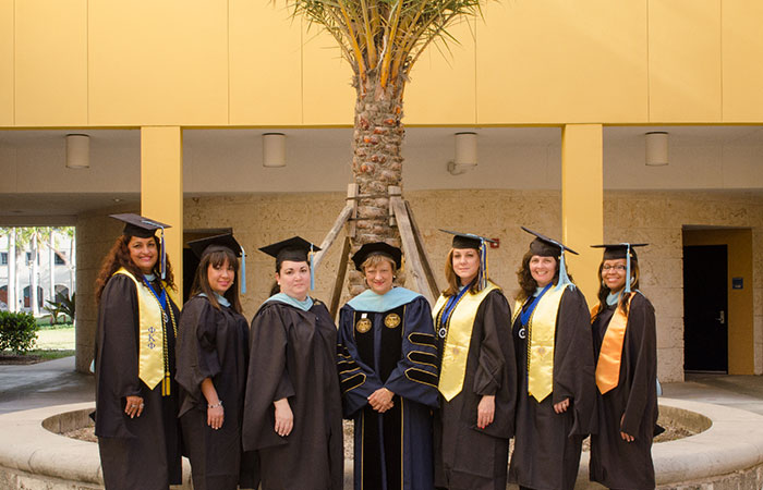 College of Education Dean Delia C. Garcia, center, is pictured with Spring 2014 CLAVE graduates. Since 2009, two cohorts of students have graduated from the Master of Urban Education program. A third cohort is expected to graduate this fall.