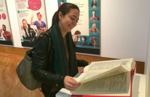 Romeu takes a closer look at a sample copy of the Folio, also on display in the exhibit.