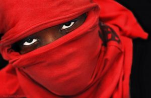 One of Carl Juste's photos of a Haitian man wearing a red t-shirt as a mask. Photo courtesy: Carl Juste