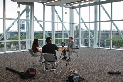 FIU Magazine Editor Deborah O'Neil and Senior Multimedia Producer Doug Garland interview Chad Moss '94 in the new Parkview student residence hall.