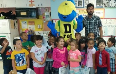 FIU student Xu Huizhong dressed up as D-Rop, a water conservation mascot to educate preschoolers on water conservation.