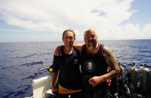FIU Marine Scientist Mark Bond (left) goes free diving in a shark feeding frenzy for Discovery Channel's Shark Week.