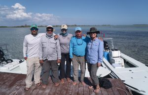 FIU fish ecologist Jennifer Rehage (center) poses with colleagues from Bonefish Tarpon & Trust and the University of Havana in Las Salinas, Cuba, one of the Caribbean's most prominent fishing sites. Photo by Richard Kern.