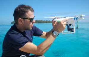 FIU Researcher Jeremy Kiszka prepares a drone for deployment for a shark survey along the island of Moorea.