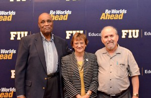Erskine Dottin, College of Education Dean Delia C. Garcia, and Leonard Bliss pose for a photo at a ceremony honoring the four retiring professors from the College of Education. Bliss, Dottin, and professors Linda Blanton and Joan Wynne are stepping calling it a career.
