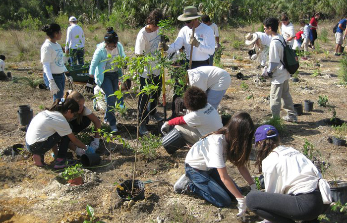 FIU and Zoo Miami hosted students from West Miami Middle School to restore pine rockland on Earth Day, April 9.