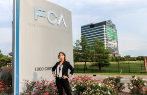 Amanda Cano at the entrance of FCA building