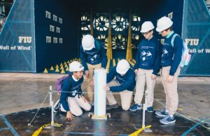 Students from Florida Christian School set up their model building in front of FIU's Wall of Wind fans