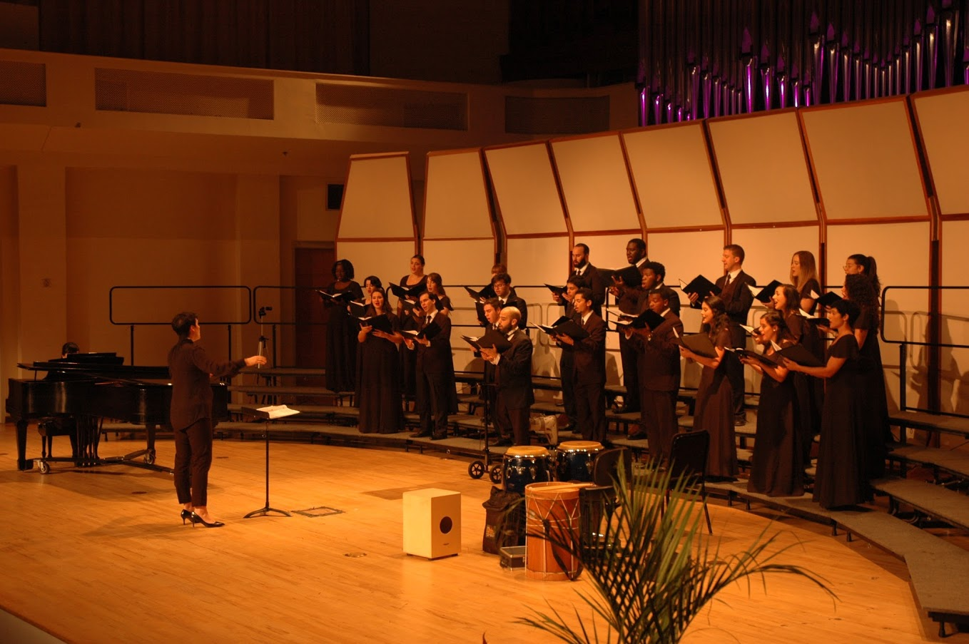 Choral Conductor Kathryn Longo and one of her choir classes during a concert