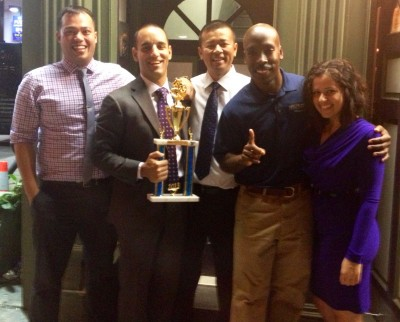 Members of FIUNYC Co-Ed Softball Team after receiving their YSA Conference Championship Trophy at American Retro Bar & Grill in on Oct. 15 in NYC. Pictured l to r: T. Nikki Chawla '06, FIUNYC Softball Manager Thomas Ruggiero '05, Hieu Pham '97, FIUNYC President Cedric L. Bess '99, and Jassie Vilela '04.