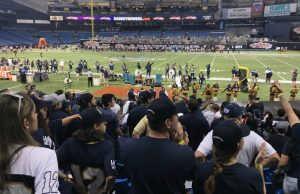 Fans stand and cheer as FIU scores for the first time of the game.